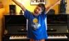 Happy kid with piano